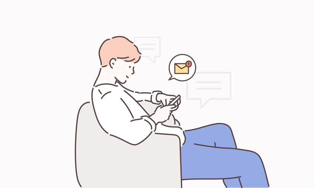 メッセージのやり取りをしている男性のイラスト