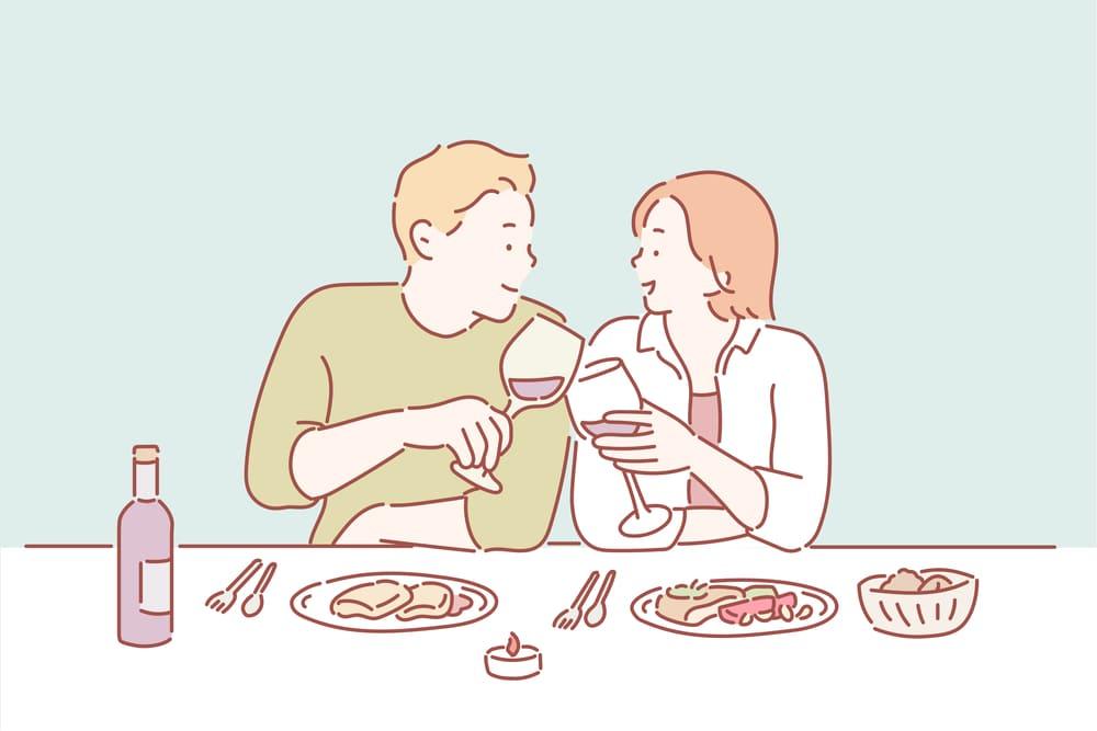 食事をしている男女のイラスト