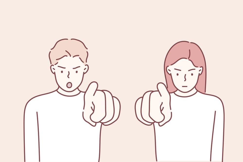 指をさしている男女のイラスト